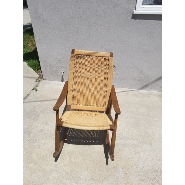 Original Hans Wegner design inspired paper cord hand weaved rocking chair dating back to the 1960s.