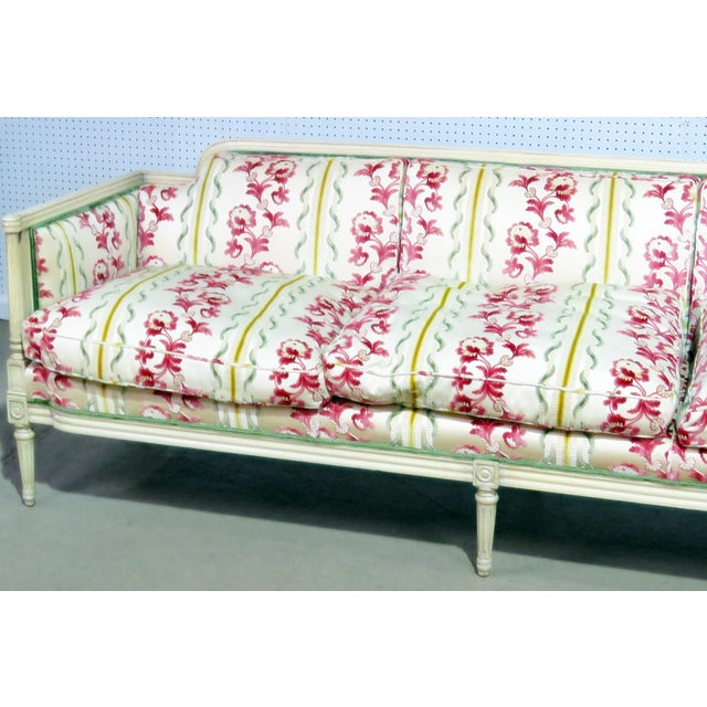 Louis XV style distressed painted sofa with textured upholstery.