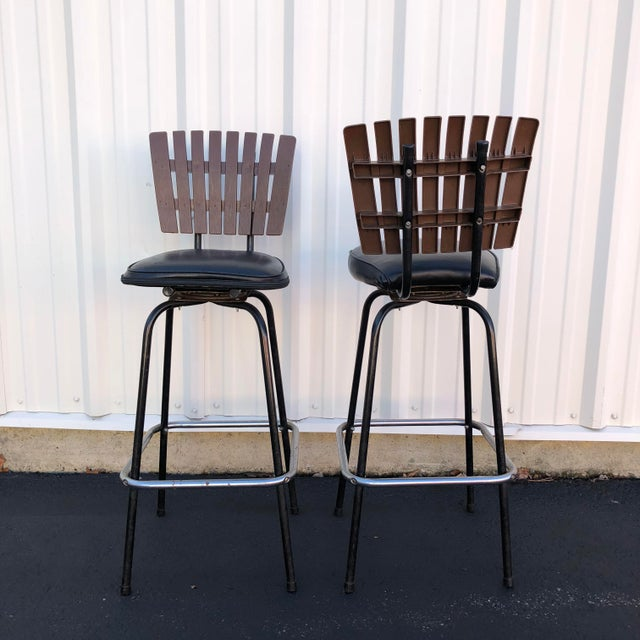 Mid 20th Century Black Swivel Bar Stools With Faux Wood Seat Backs - A Pair For Sale - Image 5 of 13