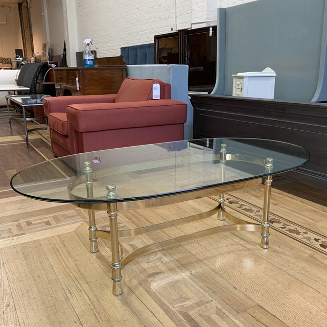 Design Plus Gallery presents a Maison Jenson Style Polished Brass + Glass Coffee Table. The elegant lines of base are...