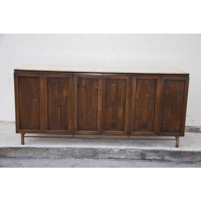 We love this striking MId-Century piece. This Cityscape Brutalist Style Credenza is by Johnson Furniture Company of Grand...
