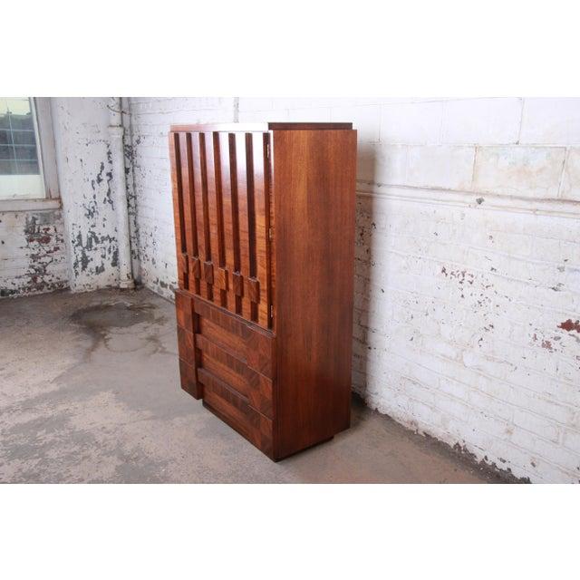 A gorgeous Paul Evans style mid-century modern brutalist walnut gentleman's chest or armoire dresser By Lane Furniture...