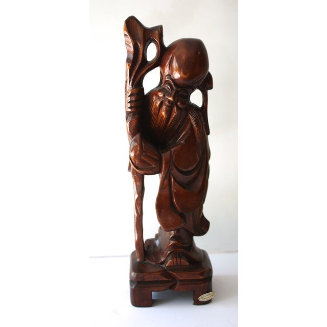 """1970's carved wood buddha statue. A fabulous vintage accessory to add to any decor. Marked """"Made in Taiwan."""""""