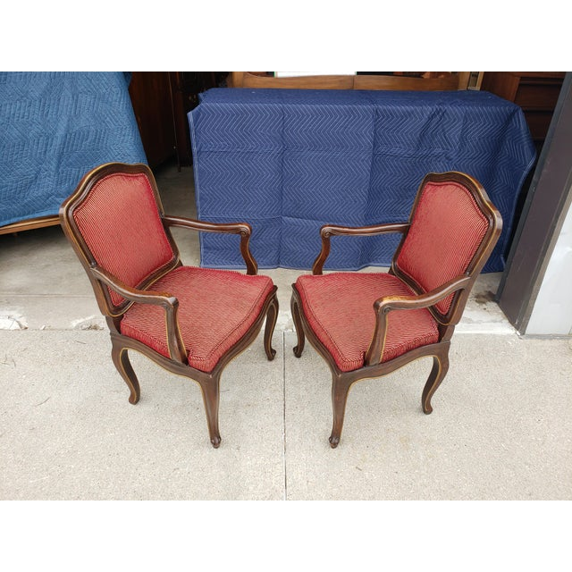 Beautiful pair of vintage Henredon French Regency Style armchairs with solid wood frames and high end designer fabric....