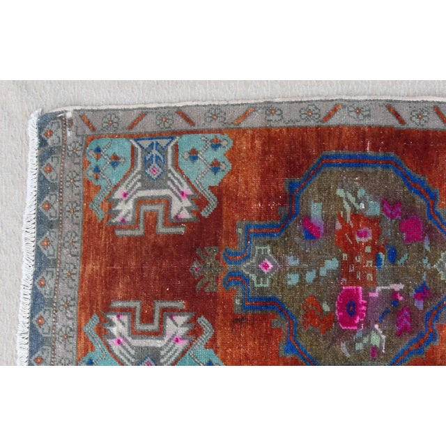 Hand-knotted Turkish wool accent rug in wonderful muted rusts, creams, teals and gray hues. Some wear consistent with...