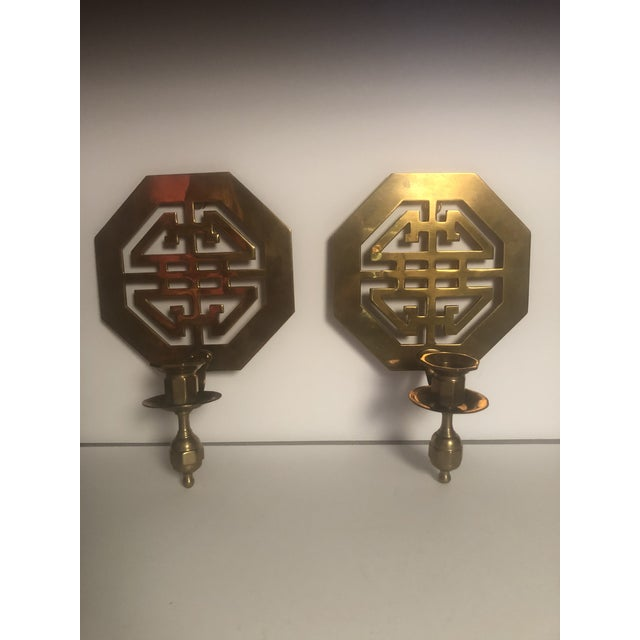 Beautiful pair of mid-century wall brass candleholders scones with a geometric pattern Each scone has a ring to hang on...
