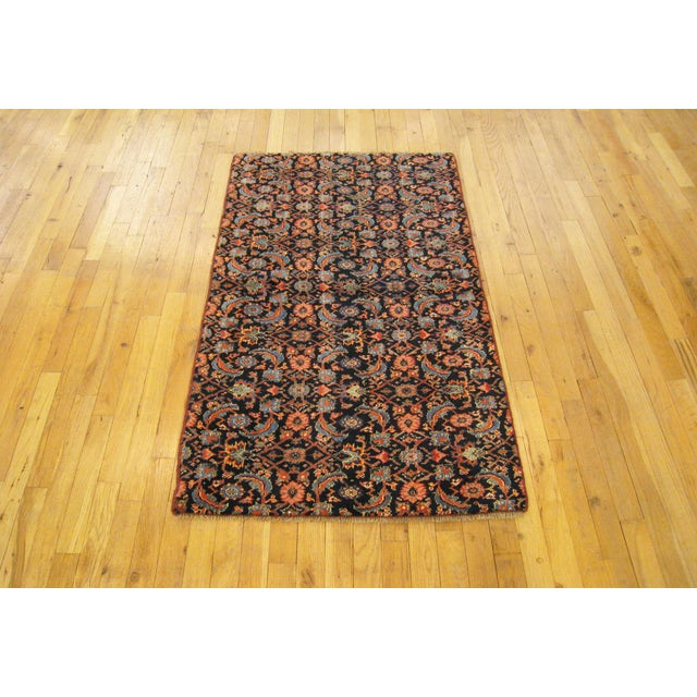 "Antique Persian Bidjar Rug 4'6"" H x 2'7"" W , in Small Rug Size, circa 1920. This fine floral wool rug features a repeating..."