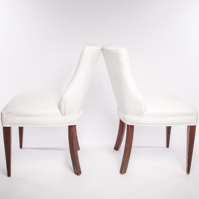 Gorgeous pair of vintage French side chairs in white leather.
