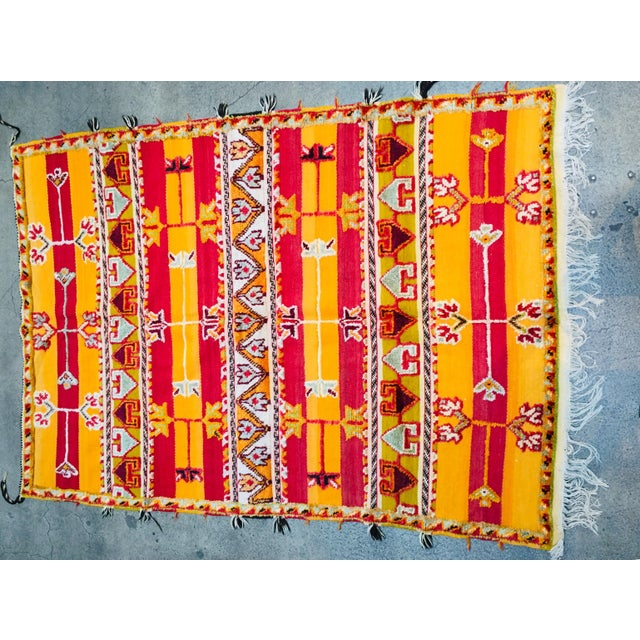 Moroccan vintage tribal rug, handwoven by the Berber women of Morocco. Mixed of flat and pile weaving work. Geometric...