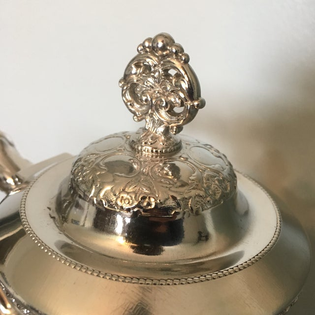 Quadruple silver plated coffee service with sugar bowl and creamer. Lovely hand etched detailing on the bodies of all...