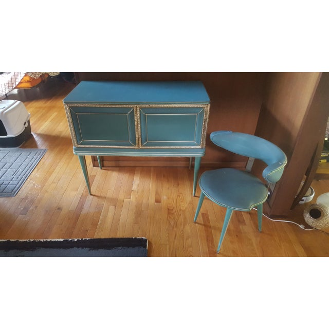 One of a kind, gorgeous turquoise and gold table and matching chair in a Hollywood Regency theme. Made out of vinyl with...
