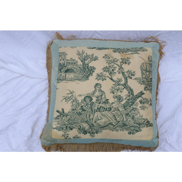 This English Country style silk down-filled pillow in three shades of blue is trimmed with tan fringe. The English country...