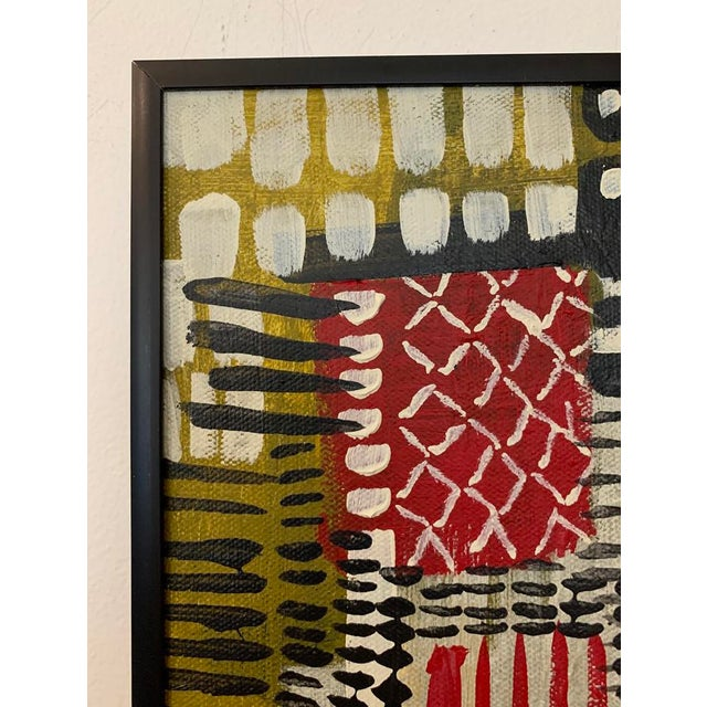 This colorful patchwork of reds, yellows, greens and blacks is framed in a modern black frame and arrives ready to hang....