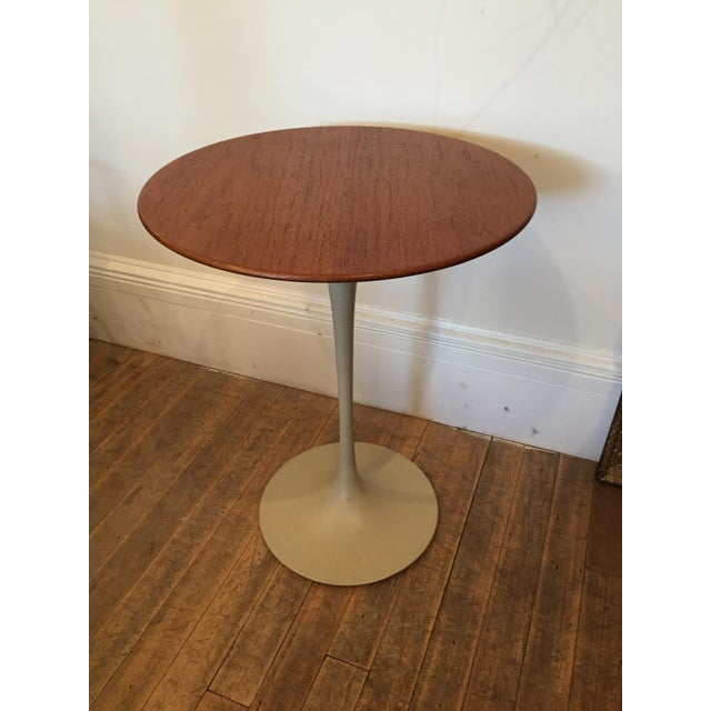 This modern classic was designed by Eero Saarinen and probably dates to the early 70's. Walnut top with almond base. Age...