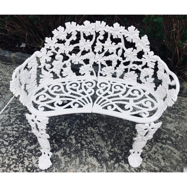 Lovely, complementary pair of cast iron garden seats. The Victorian bench is 31 inches wide, 12.5 inches deep and 28...