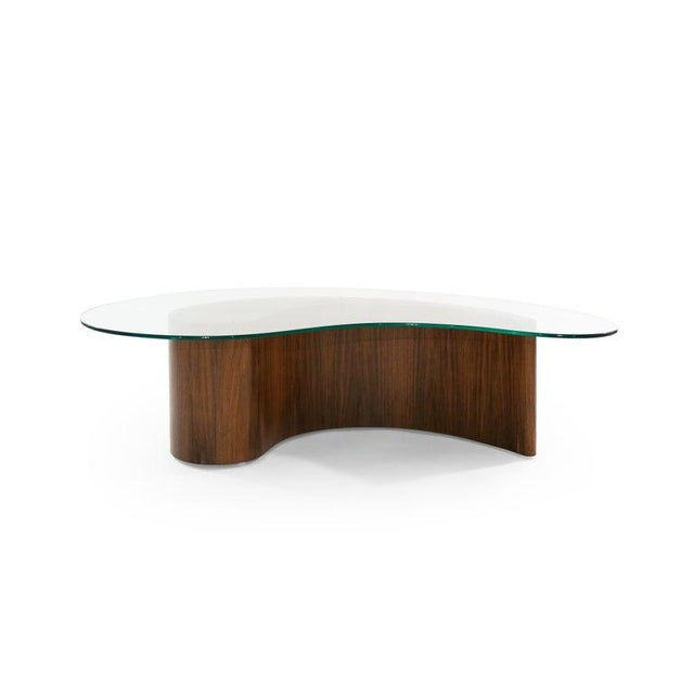 An apostrophe shaped coffee table attributed to Vladimir Kagan, circa 1950s. Walnut fully restored, new glass top.