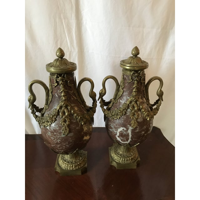 An Important Pair of Marble and Bronze Gilt Urns with Bronze Mounts. Beautiful aged Patina to the Bronze mounts. Red and...