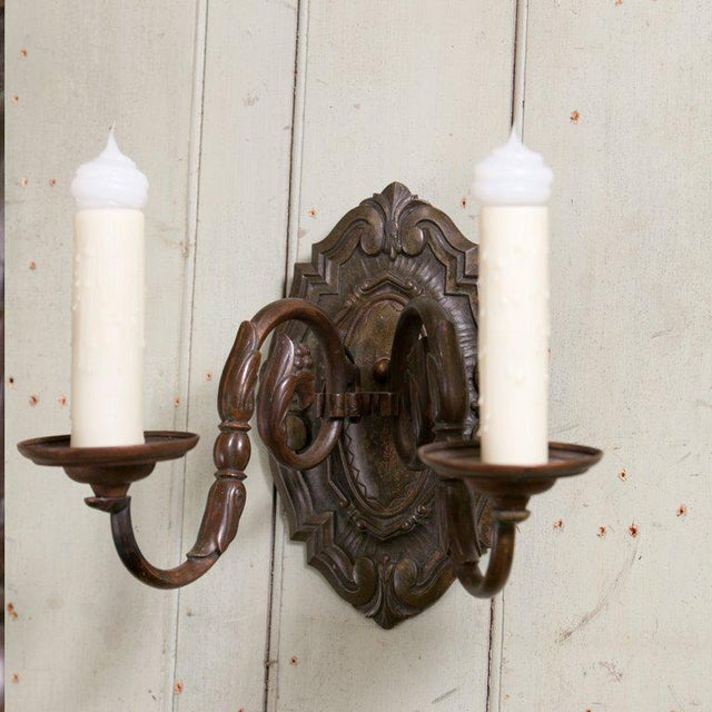 Heavy bronze sconces with two arms from Belgium, circa 1910. Beautiful patina and design. Newly re-wired in the US with...