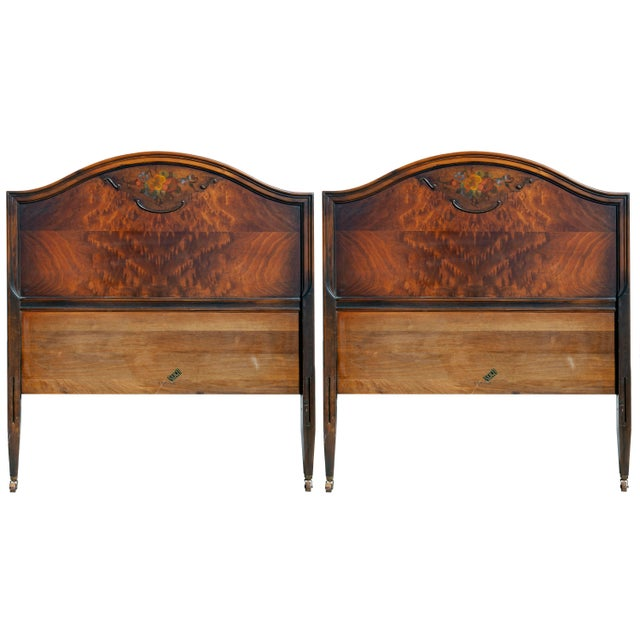 Two twin size headboards with hand painted floral accents by Sleigh available. Constructed with walnut frame and burled...