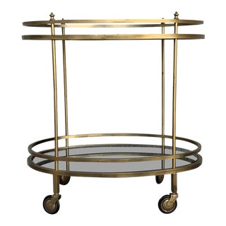 Mid Century French Gilt Metal Oval Bar Cart Trolley With Smokey Glass For Sale
