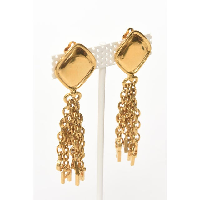 Modern Vintage Chanel Pair of Gold Plated Charm Dangle Clip on Earrings For Sale - Image 3 of 10