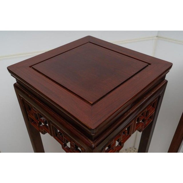 This stylish rosewood Chinese pedestal was acquired from a Palm Beach estate and they can be purchased as a pair for...