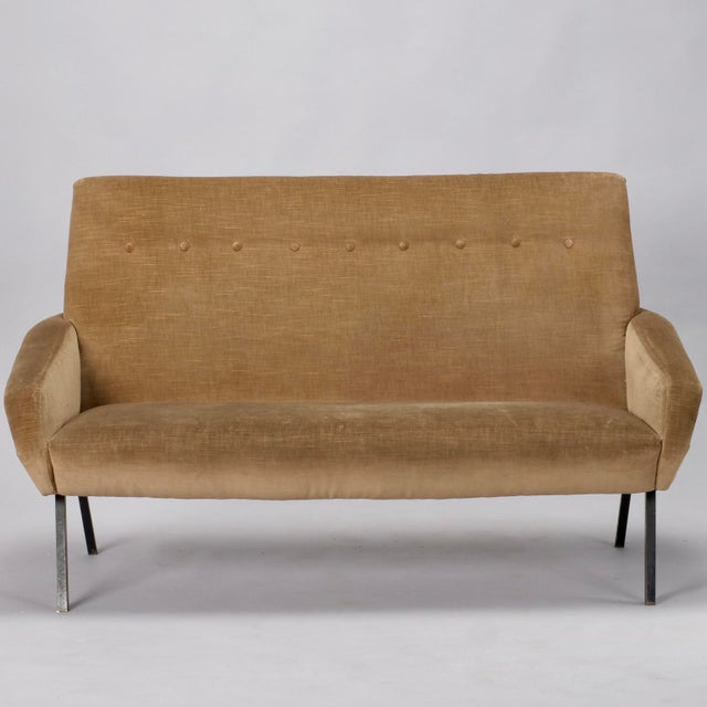 Italian settee in manner of Zanuso has tight seat back with a single row of button tufting, brass nailhead trimmed arms...