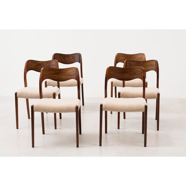 Stunning set of six Niels Moller dining chairs model #71. Solid rosewood frames, seats reupholstered in a sumptuous Leo...