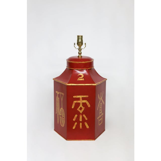 This vintage tea caddy lamp is constructed out of tole and is painted with old style chinese characters representing...