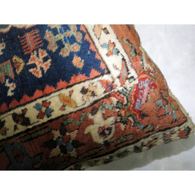 Pillow made from a antique heriz rug with cotton back. Zipper closure and foam insert provided. 17'' x 20''