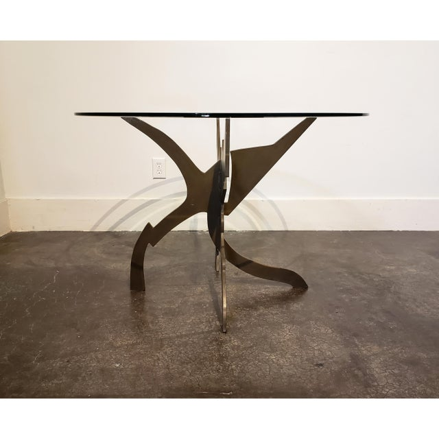 Patinated steel and glass dining table designed by Pucci De Rossi, circa 1987. Comprised of two welded-together, thick,...