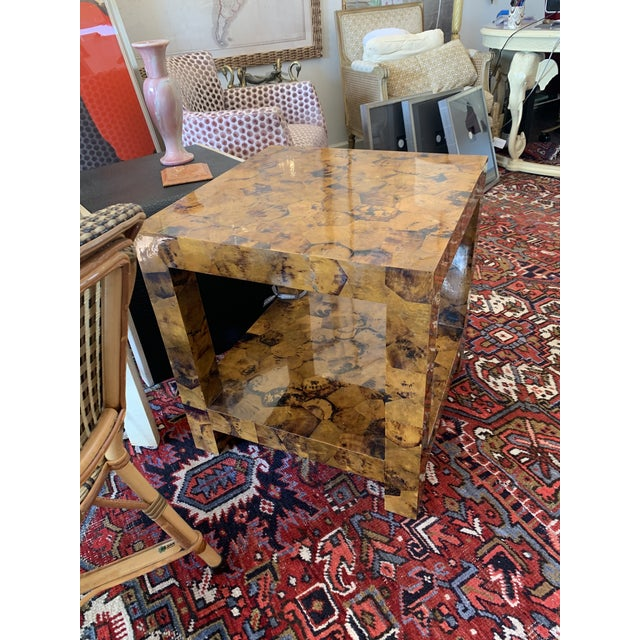 This is a fabulous table made by the Kravet Company. It has such a presence. Made of young pen shell, the scale is...