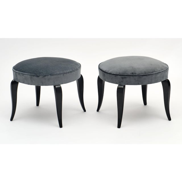 Two gray velvet Art Deco period stools made of ebonized cherry wood. We love the cabriole legs and French polish finish....