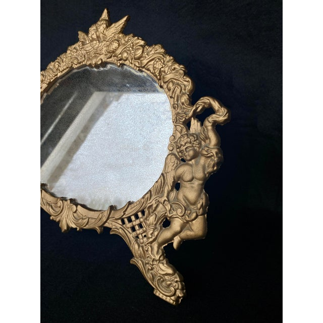 Mid 20th Century Vintage French Rococo Louis XV Gilded Brass Cherub Motif Oval Table Mirror For Sale - Image 5 of 10