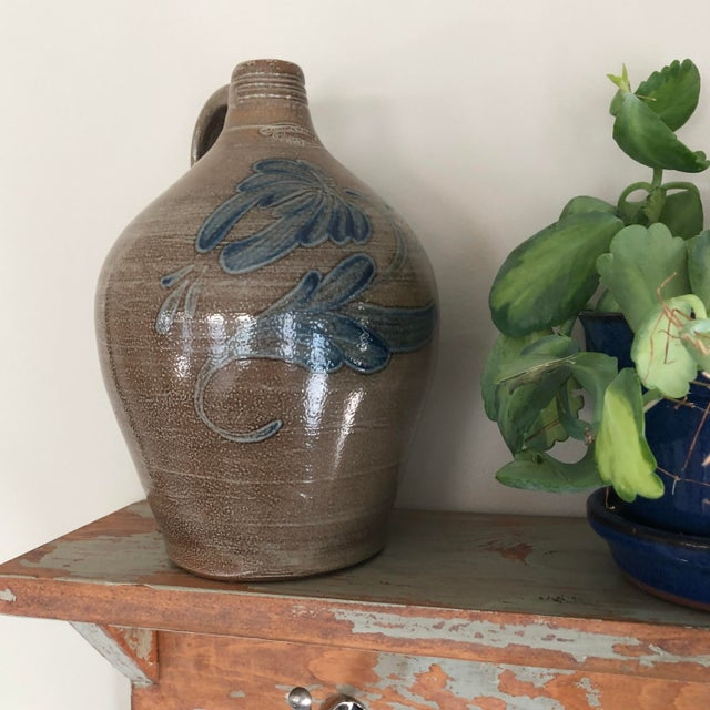 Country chic 'Wisconsin Pottery, Columbus WI' jug (holds 1/2 gallon) in the the Early American stoneware, salt-glazed...