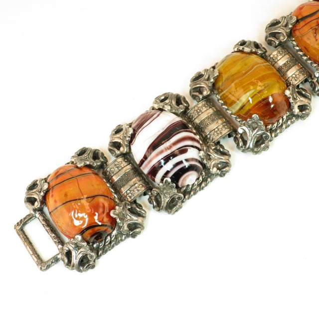 Offered here is a Mid-Century Selro Corp. silver-plated Florentine-design link bracelet from the 1950s. The construction...