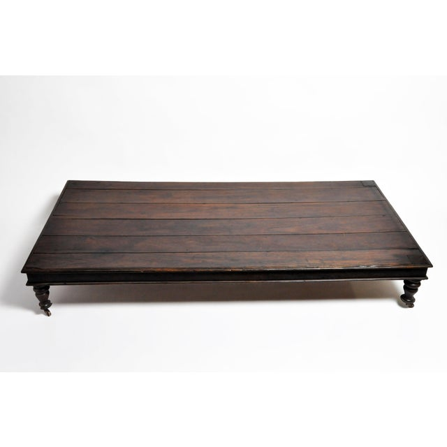 This generously-proportioned daybed dates to the British Colonial Era of Burma. It is made from hand turned teak wood and...