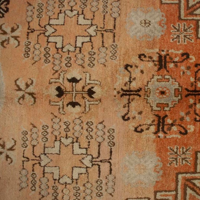 An early 20th century Central Asian Samarghand carpet with large central medallion amidst a field of tree of life motif...