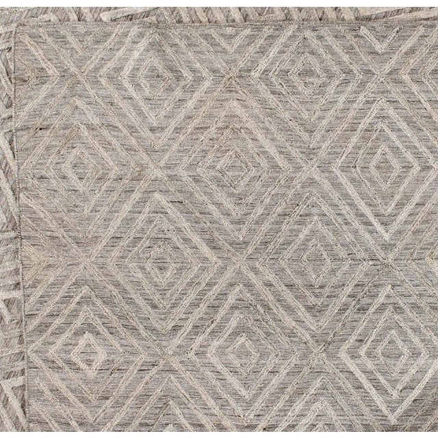 Raised diamonds against grey-scale background add texture and vibrancy to this stunning wool rug. Versatile tones will...