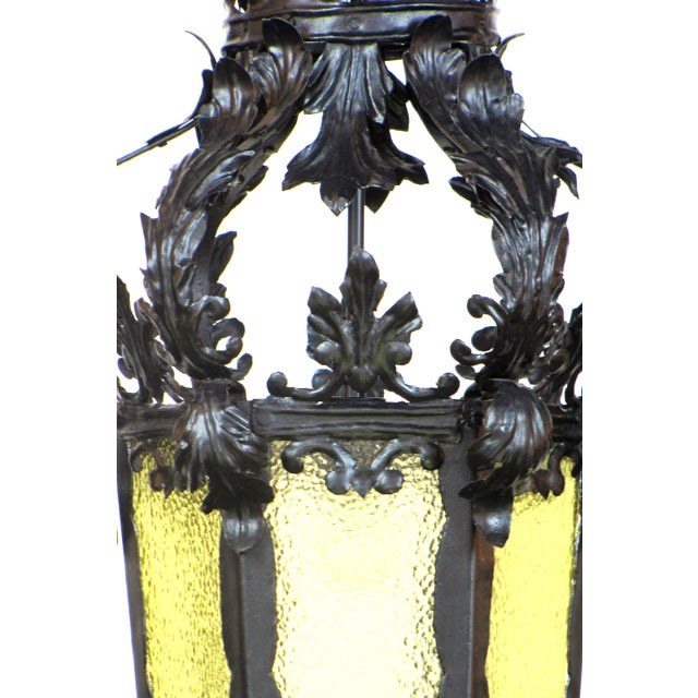 """French Provincial Lantern. Elegant wrought iron with amber textured glass. Leafy feminine form. 40"""" minimum overall..."""