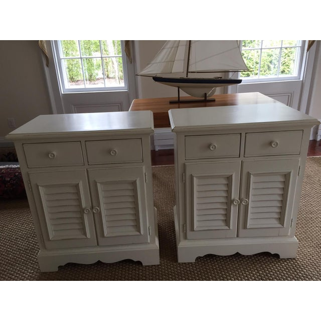 Coastal /cottage style nightstands. Antiqued off white/cream, with 2 drawers (dovetailed) and one shelf in lower cabinet....