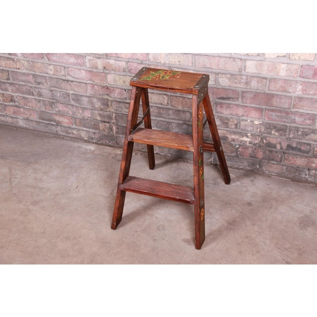 """A nice vintage wooden step ladder with hand-painted floral design USA, 20th Century Measures: 14.75""""W x 18.5""""D x 23.25""""H...."""