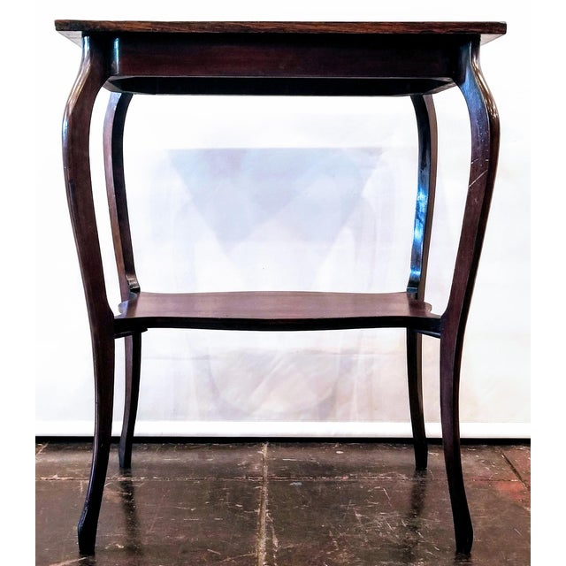 Antique rosewood parlor table with cabriole jambes (French legs that were introduced in French furniture in the late Louis...