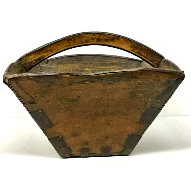 It a reproduction. I personally guarantee that this bucket is way over 100 years old. There is an iridescent sticker on...