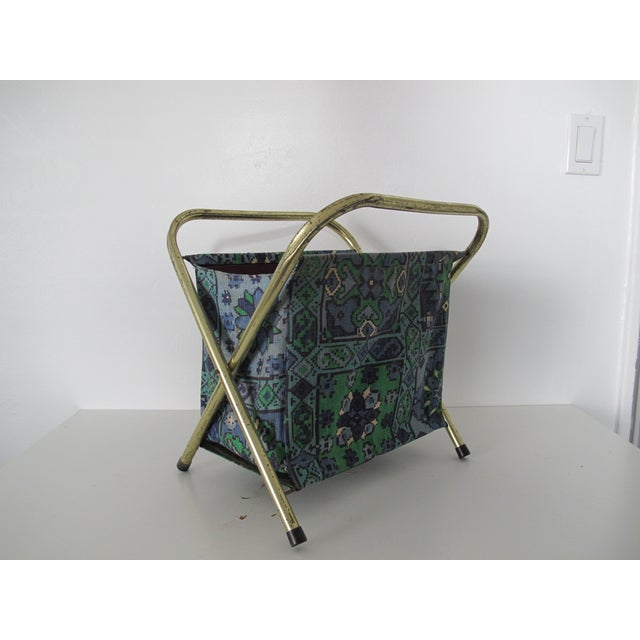 Vibrant fabric magazine file with a goldstone metal structure and a blue and green fabric basket. No makers marks
