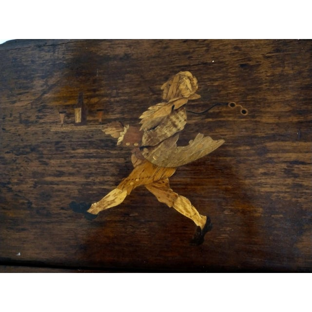 I am not quite sure what this was originally used for. It has a beautiful inlaid wood whimsical picture of a butler...