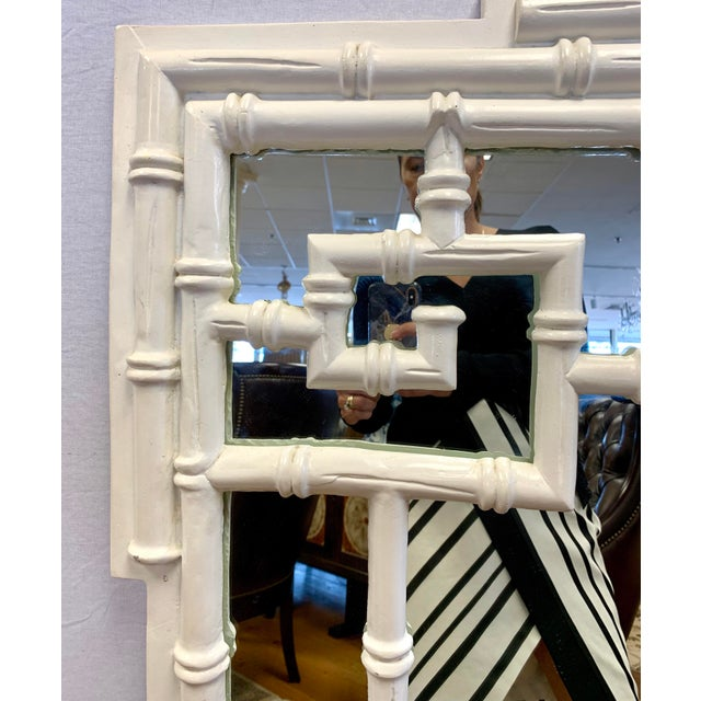Elegant chinoiserie mirror from the 1970's in a white lacquered finish. This mirror truly does make a statement....