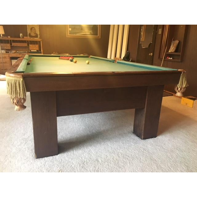 This solid wood and heavy slate-topped snooker table has been in the family for 45+ years. It was purchased from a small...