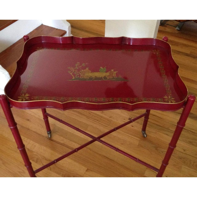 "Bar cart height, with outstanding gold pen work against the red background. Tray (26"" x 17"") is removable. The faux bamboo..."