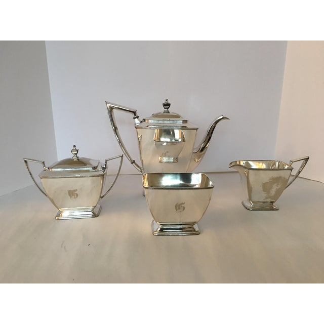 This is a vintage silver plate Pairpoint Co. tea service set with a T engraved monogram. The pieces are clean and polished...